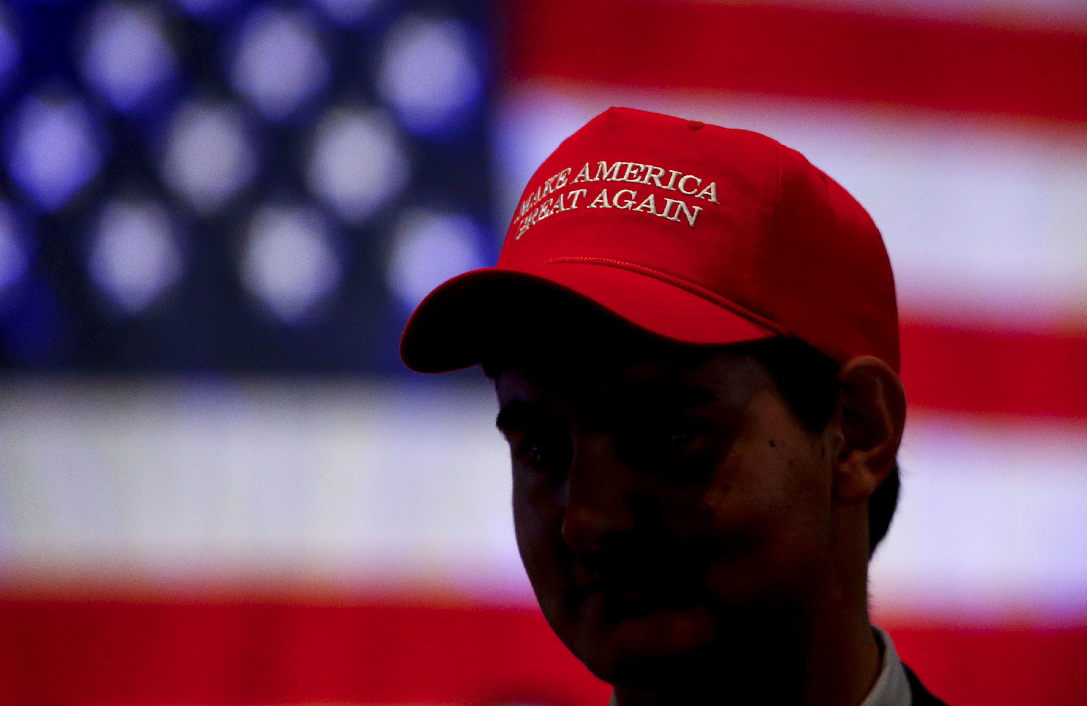 A woman was charged in the assault of a man wearing a MAGA