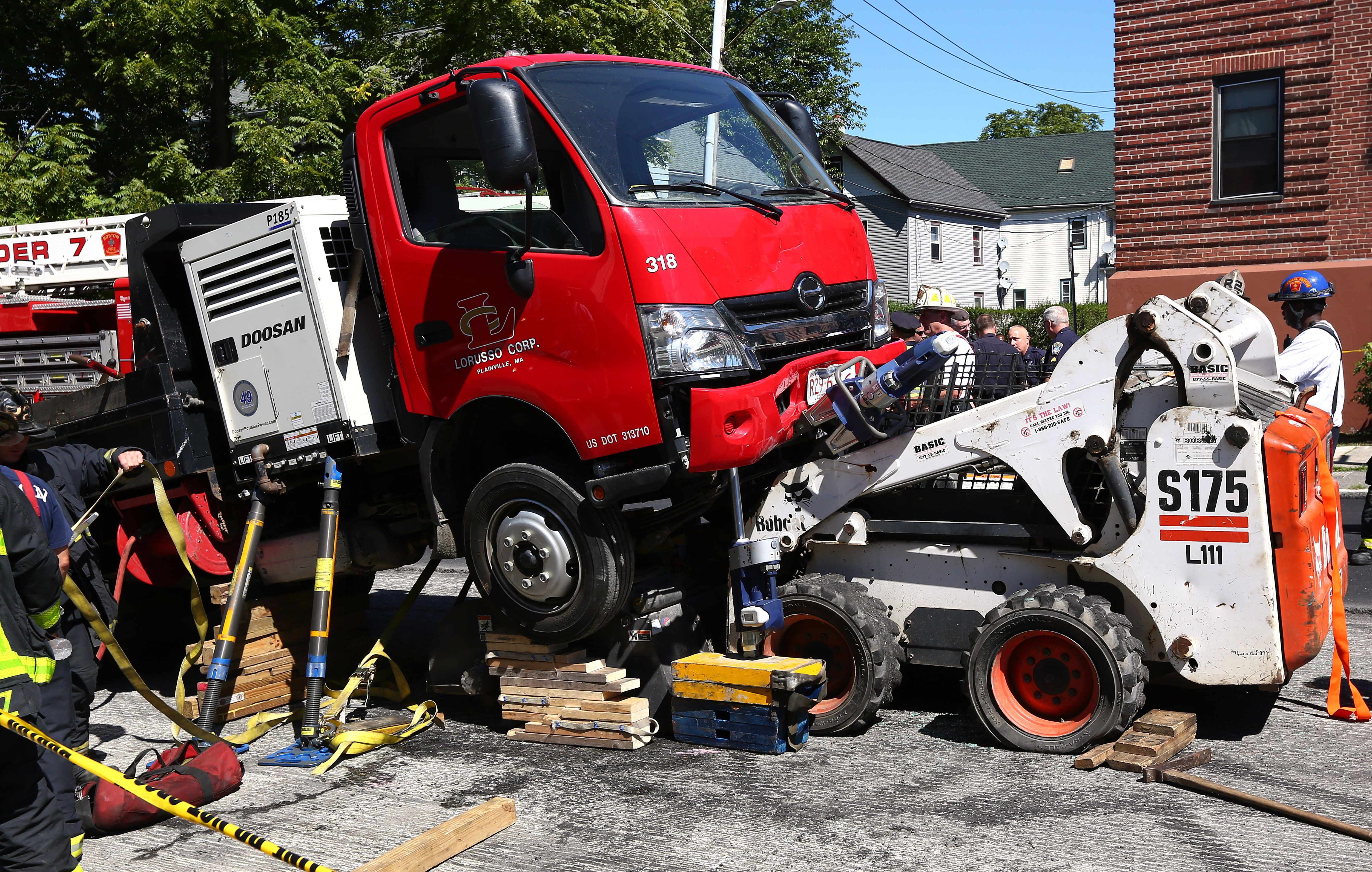 Firefighters extricate man trapped in Bobcat - The Boston Globe